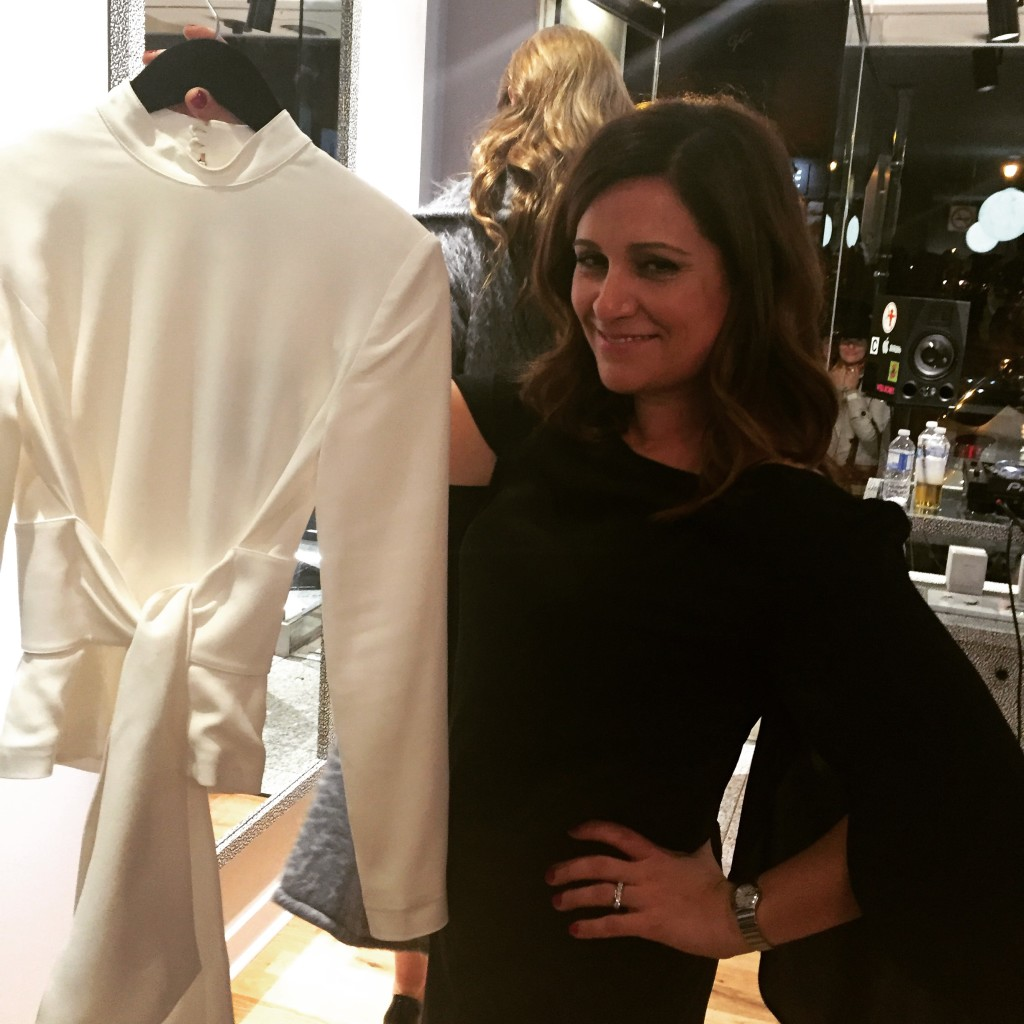 Angelica Koinis with a key piece at her Très Chic boutique launch