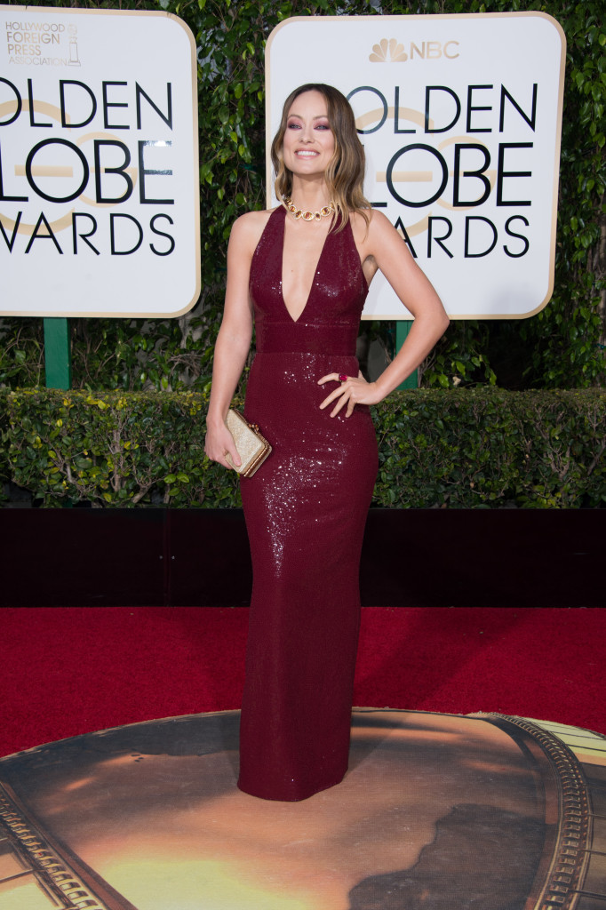 Olivia Wilde scores in a plunging Michael Kors sparkler.