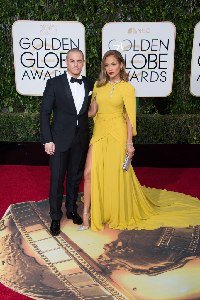 Casper Smart and Jennifer Lopez, presenter, arrive at the 73rd Annual G