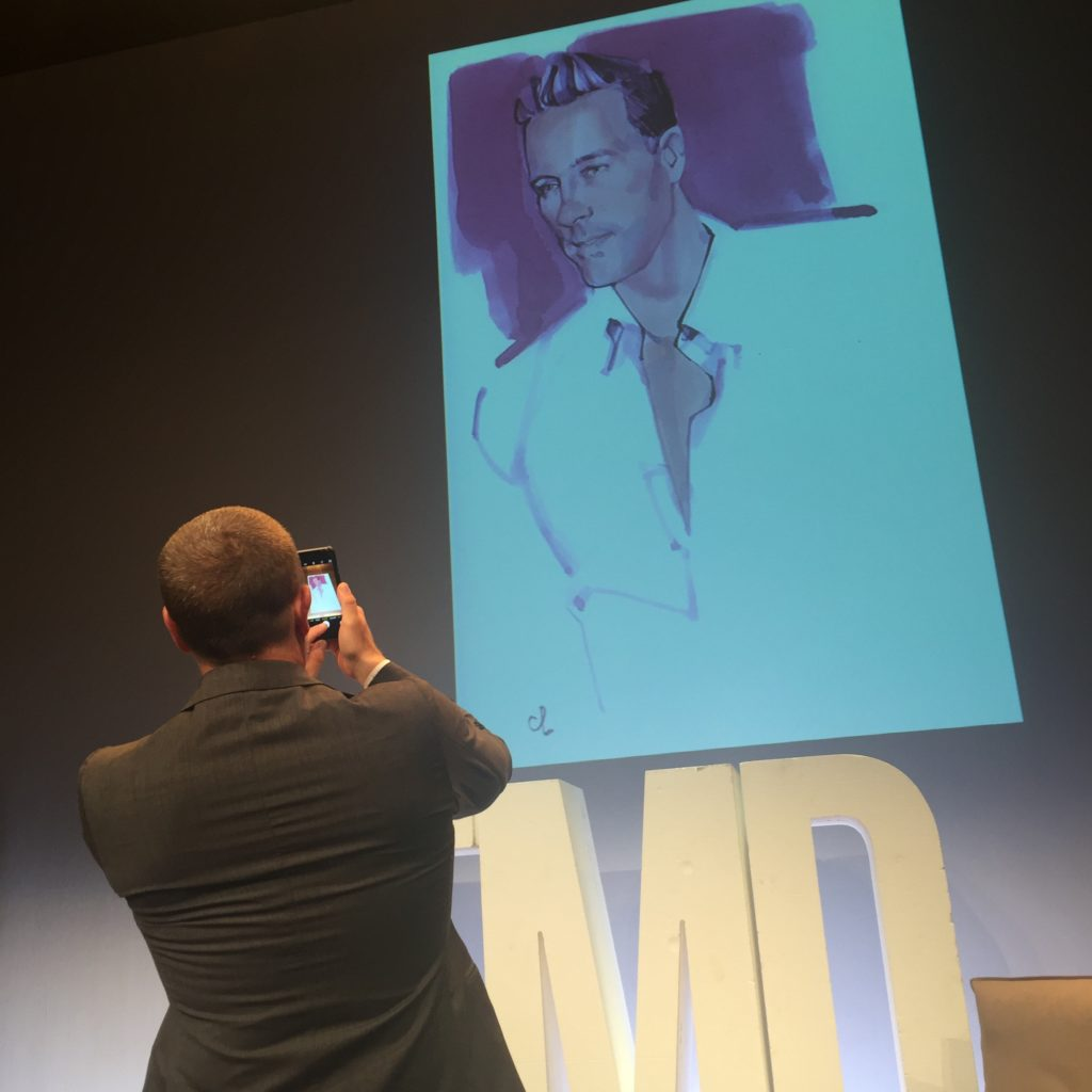 Scott Schuman snaps a shot of an illustration of himself by Marc-Antoine Coulon.