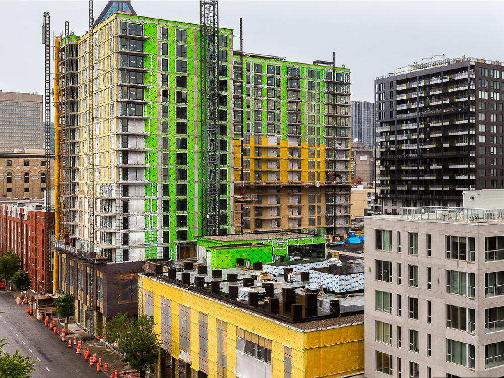 MONTREAL, QUE.: JULY 21, 2015 -- The view of Griffintown from the terrace at the Alt Hotel in Montreal, on Tuesday, July 21, 2015 looking NE at the corner of Peel, left, and Wellington Streets. (Dave Sidaway / MONTREAL GAZETTE)